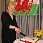 Ann Evans cuts 20th anniversary cake.