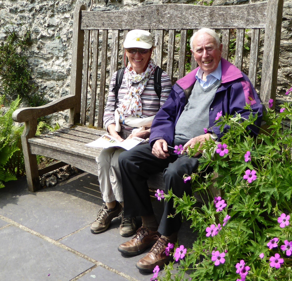 "Ann and Peter Lawrence enjoying a rest on ""Ann's Seat"" at Plas Cadnant"
